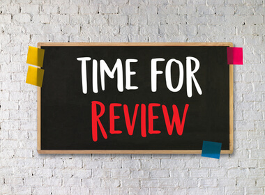 TIME FOR REVIEW on a chalkboard taped to the wall